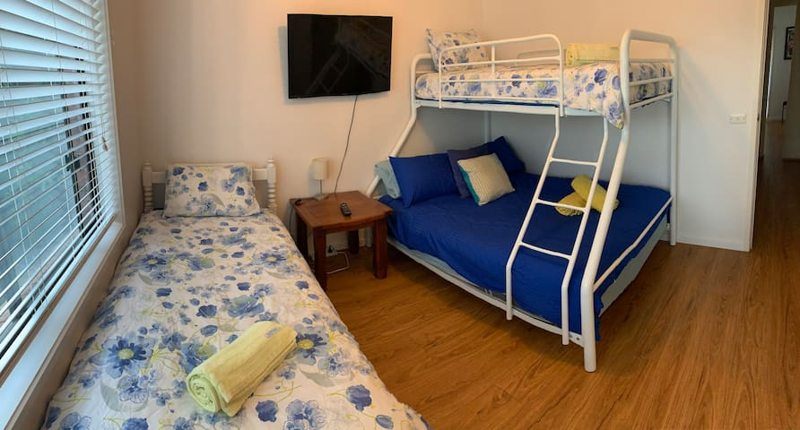 Triple bunk and single bunk. Handy room for another couple staying