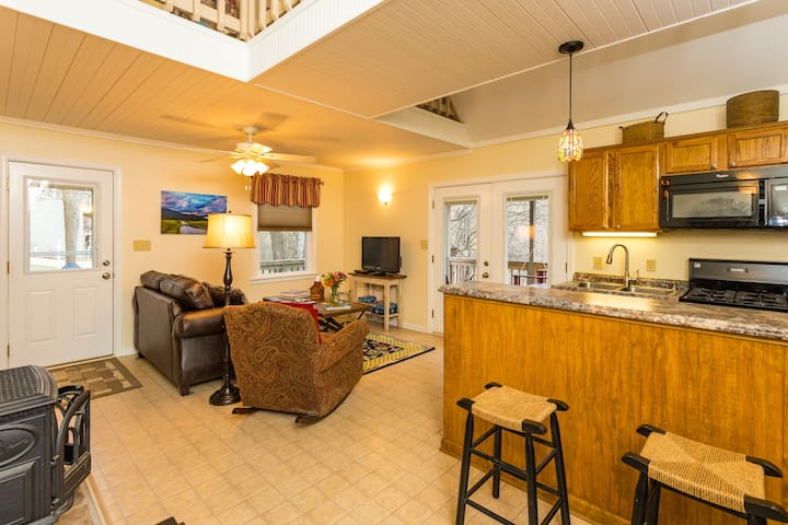 Jack's Place has a comfortable living space that opens into the kitchen and dining space.