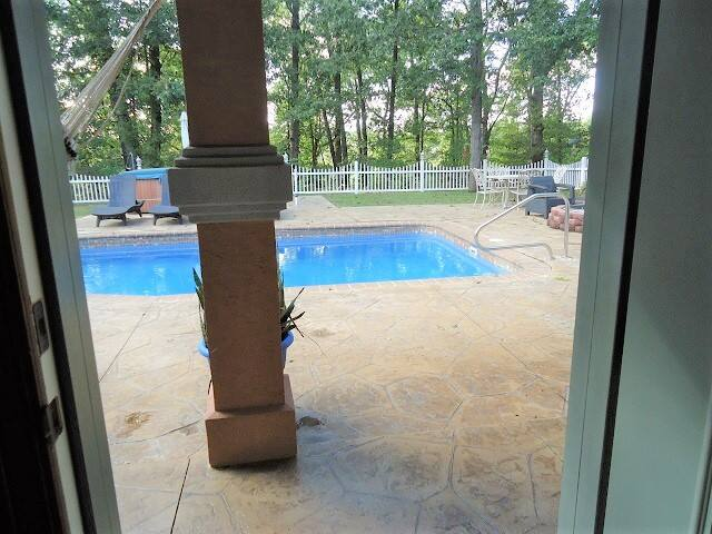 Your private suite opens to a fenced lighted yard (lit all night) and covered breeze-way to the pool (seasonal), hot tub, BBQ, Fire-pit, and multiple seating areas. All exterior and interior doors are 36 in wide. There is a 1/2 step to the front door
