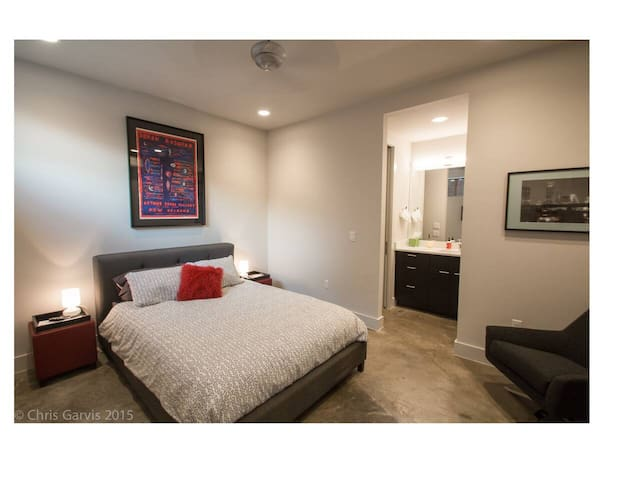Modern and spacious studio living area with queen bed