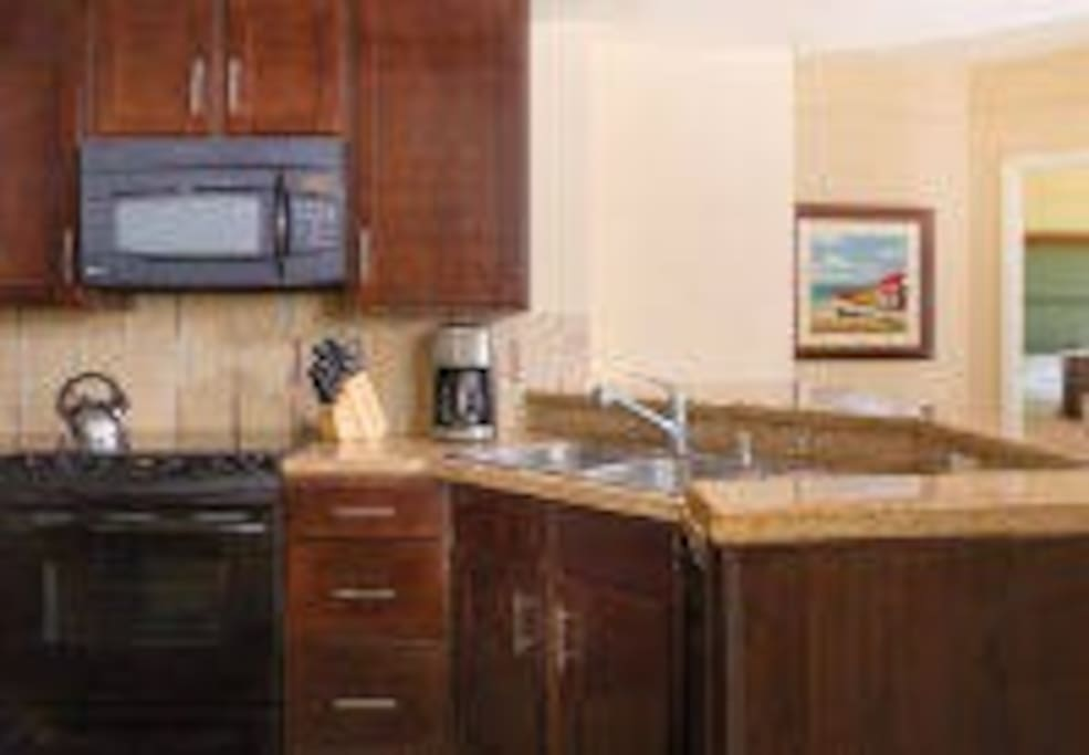 Villa Kitchen  The fully equipped kitchen in your Aruba villa rental features full-size appliances to prepare savory, home-cooked meals for you and your family.