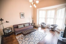 Comfortable and stylish living room with large bay window