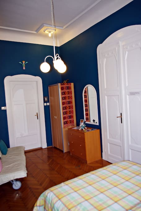 Blue bedroom with queen sized bed - this room can sleep up to 4 people