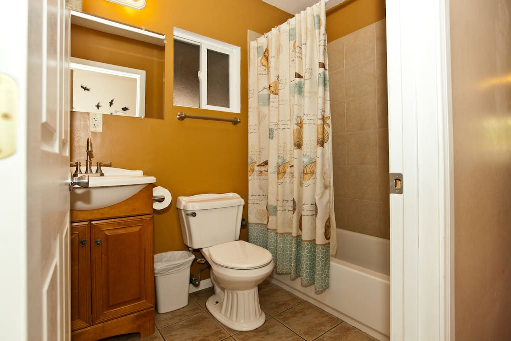 This is one of the downstairs shared full restrooms.