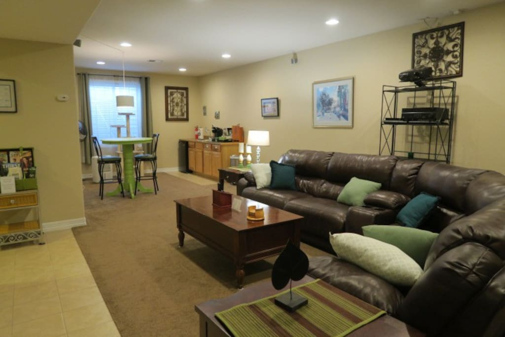 Suite includes 1-2 bedrooms, 1 bath, reclining sectional couch, projector with big screen TV, reading/dining  x 4