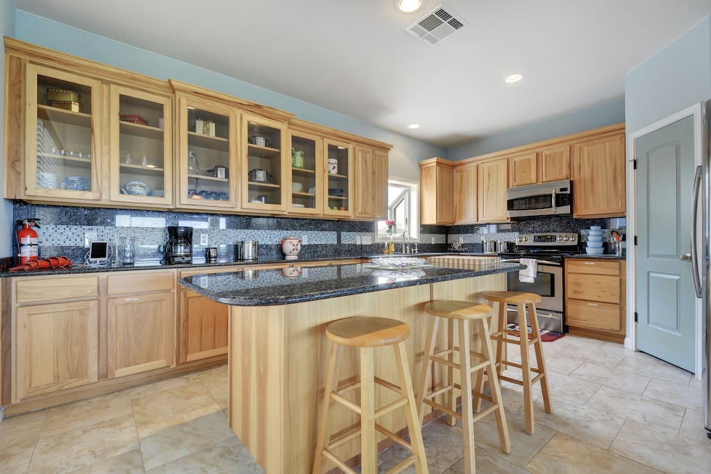 The spacious kitchen has granite counter tops.