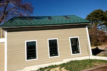 Exterior side of the Carriage House. You have three windows that bring in a lot of sunshine.