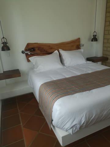 Cómoda y elegante cama Quen.
