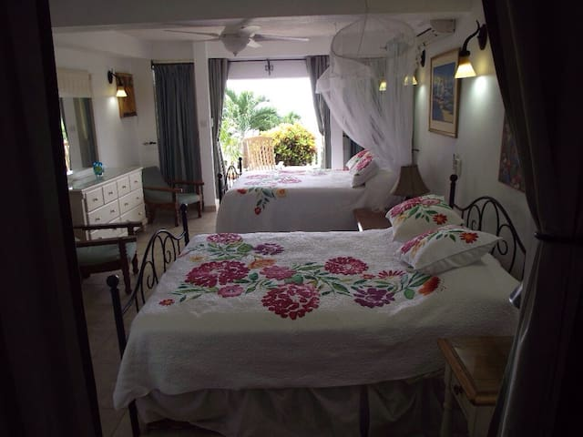 The double queen bedroom and private patio.
