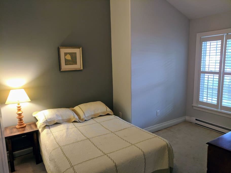 Large bright bedroom with closet and chest of drawers