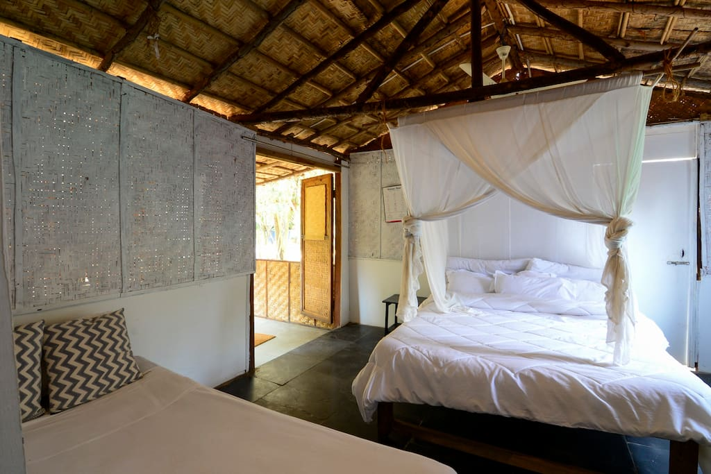 The Bedroom with High Quality Super soft Mattress and Bed Linen, Along with Mosquito Net, Jutex Hemp Rugs to ensure the most comfortable sleep