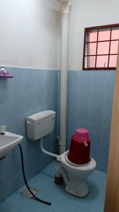 A toilet outside the bedrooms