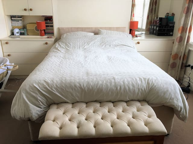Luxurious King-size bed in main bedroom