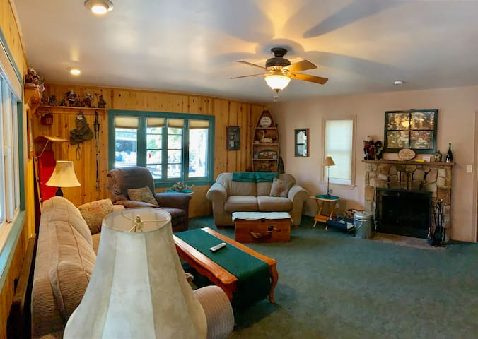 Cozy living room has plenty of room for family and friends to gather 'round a wood fire!