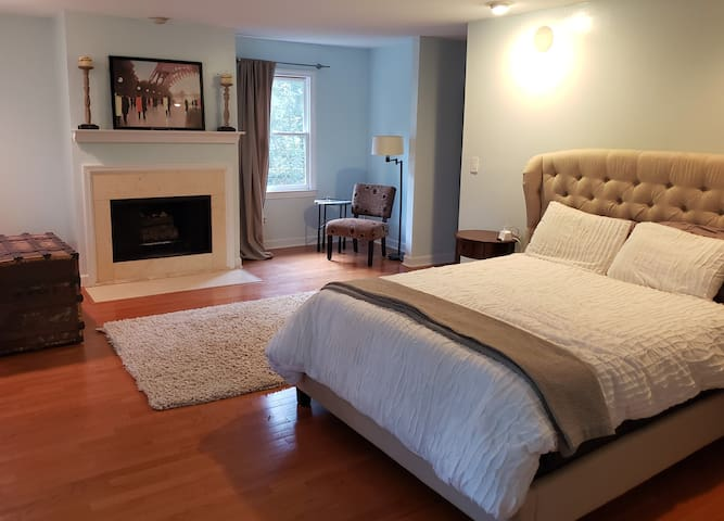 Master Bedroom with Queen, Full Bath featuring a walk-in shower.