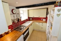 Well-designed kitchen with dishwasher, oven, microwave