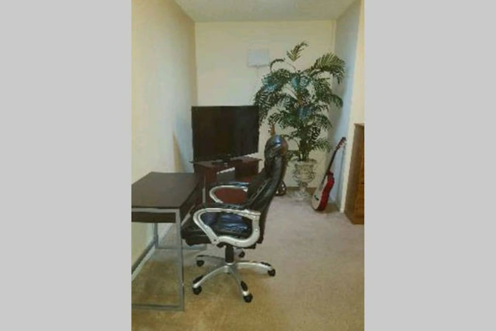 "Desk/table, leather chair, 40"" HDTV"