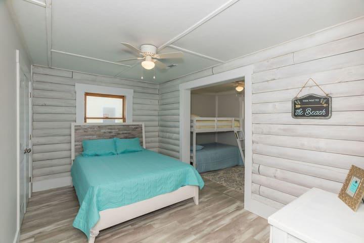 Bedroom 1. Queen bed & 1 bunk bed.