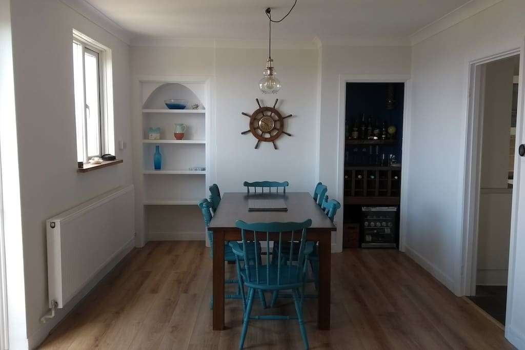 Dining room - please help yourself to a drink from the bar or drinks fridge!
