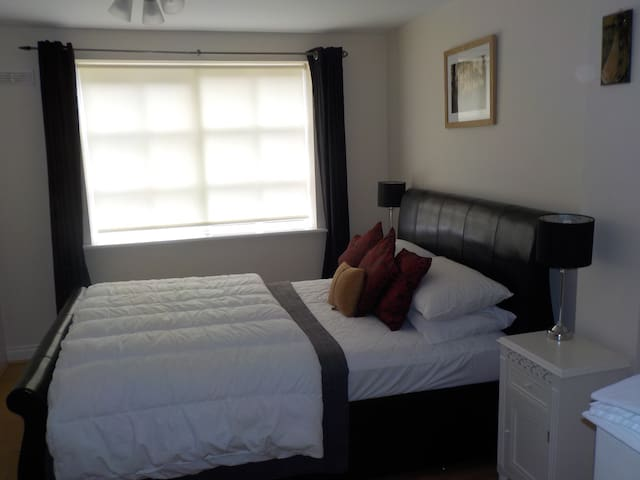 double bedroom with king size bed and fitted  wardobes