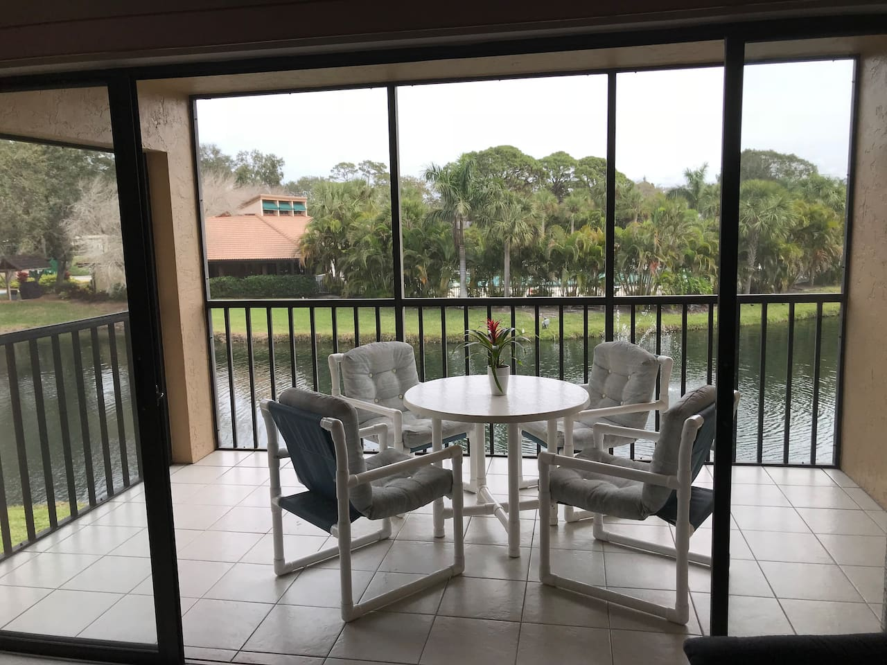 Lanai with two open views of pond; fountain, trees, birds and clubhouse.