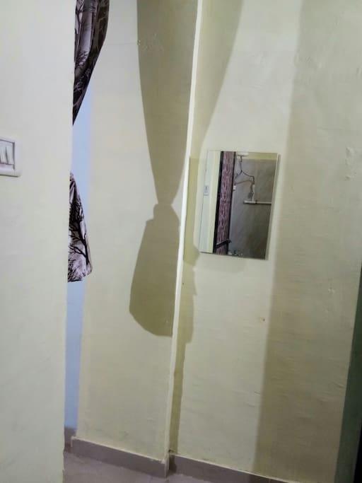 Mirror in front of Bathroom