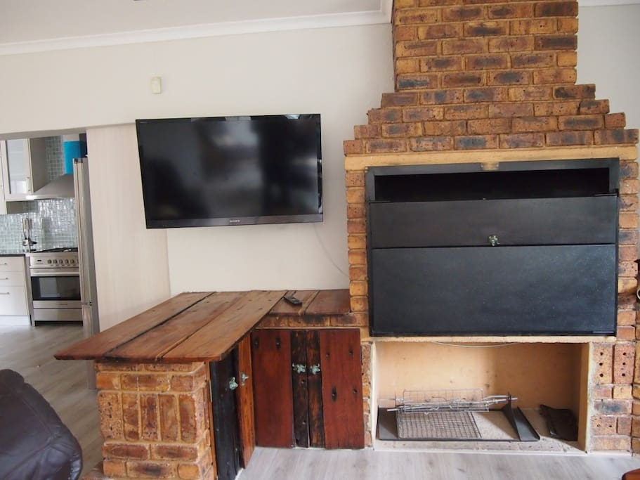 Indoor fire place suitable for barbeque.