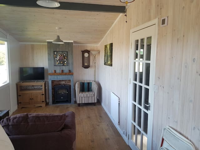 Quaint wooden lodge in West Wales countryside