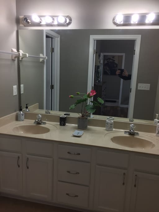 Master bathroom with his/her sinks