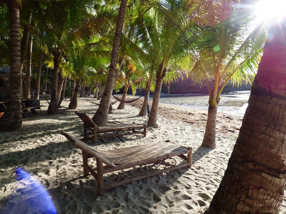 Relax at the beach. We provide beach towels and hammocks.