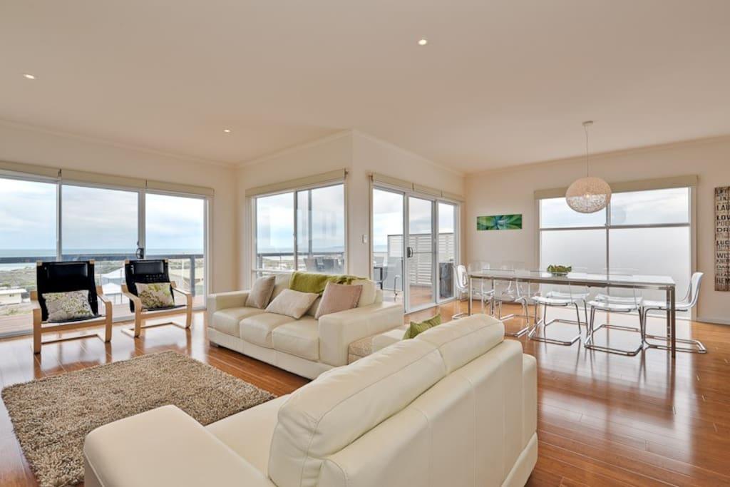 Open plan living upper floor with views to sea