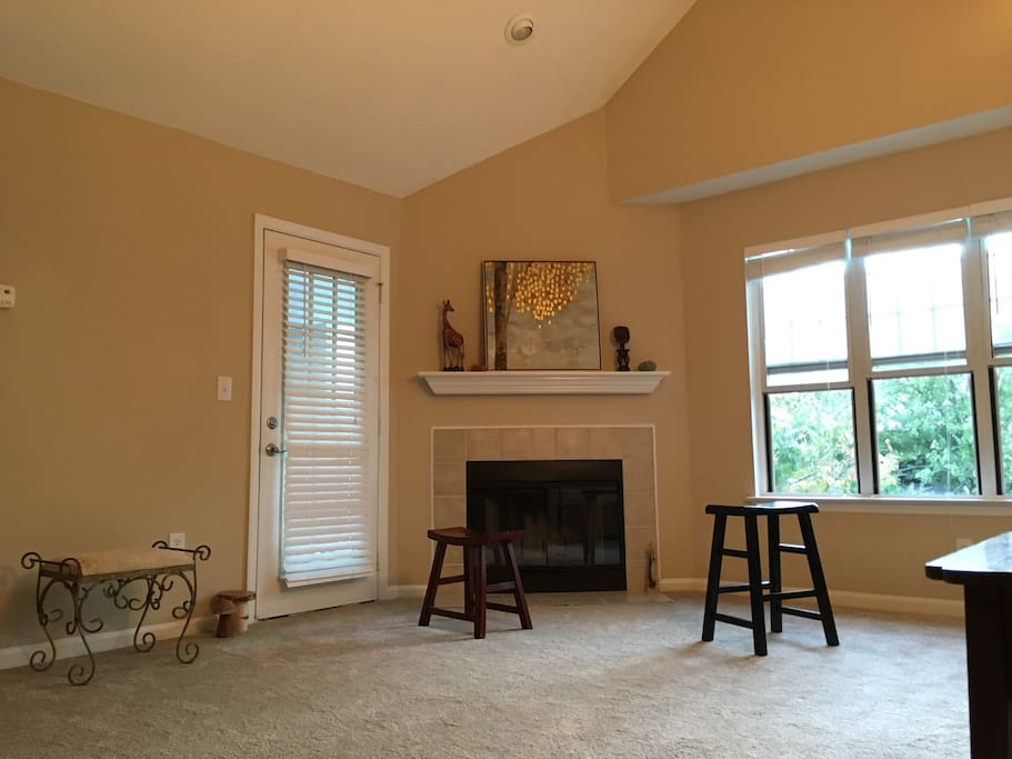 The common living room has lots of windows, top-floor views, evening sunsets, a wood-burning fireplace, tons of floor space, and a nice little deck.