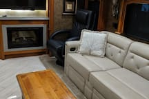 Livingroom with 2 TVs and fireplace