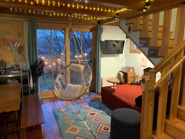 Cozy living room lights up at night. There are 2 flights of stairs to the loft.