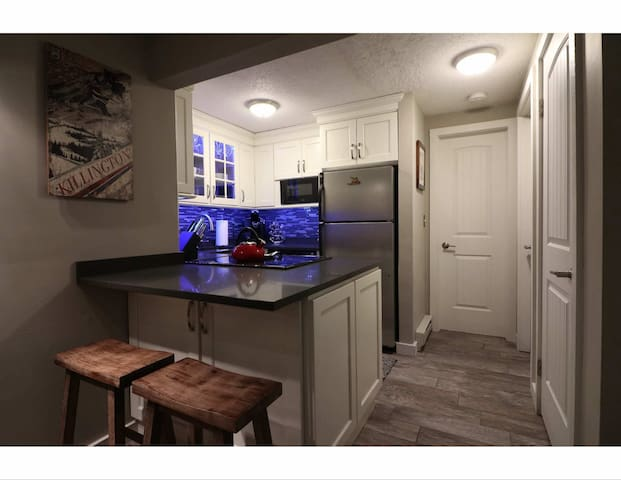 New kitchen with Caesarstone countertop and color changing led lights