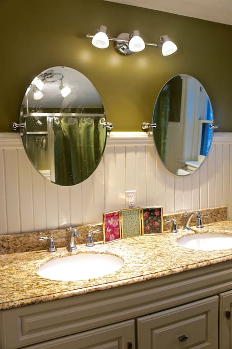 Shared Bathroom with Double Vanity Sink.
