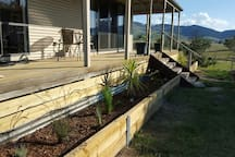 Nice veranda along 2 sides to sit and relax and watch the kids play and the cows graze.