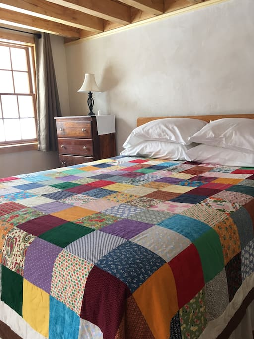 Hand made quilt covers new queen size bed.