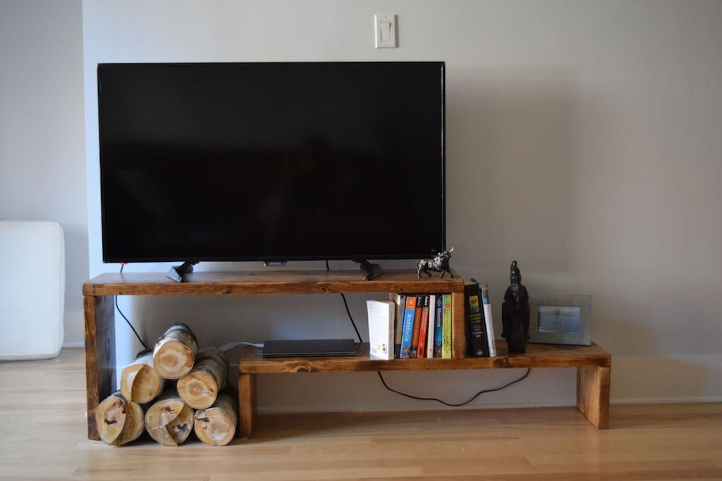 TV set up next to the corner for the bed.