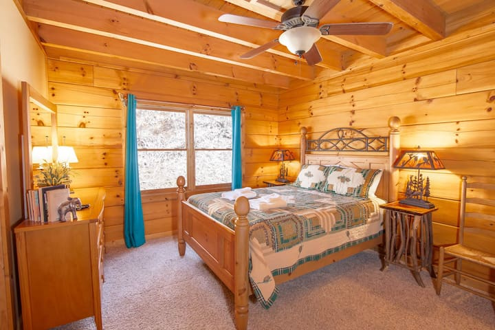 Main Level Bedroom with Queen Bed, and Twin over Twin Bunk Bed