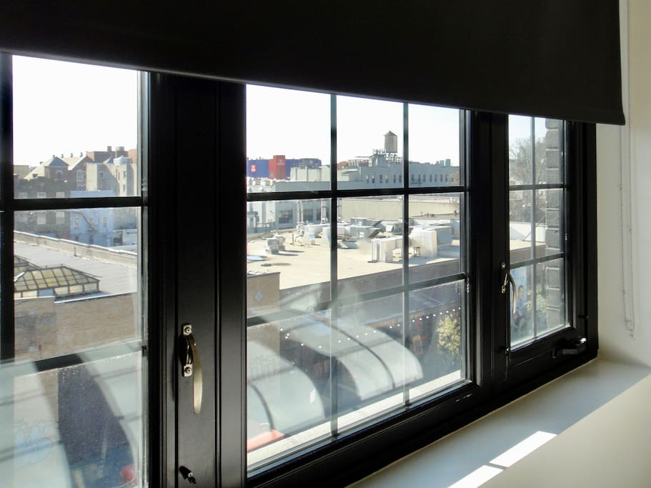 Large Factory Windows Featuring Various Views Of The City And The Neighborhood