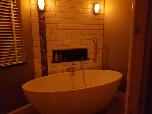 A bath at night is a must. Flame effect bulbs set the scene.