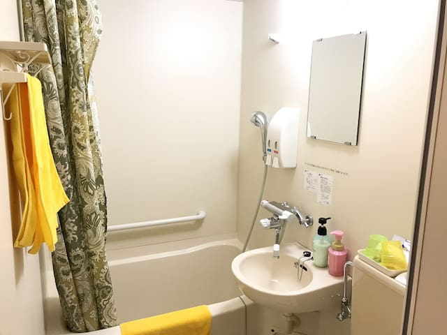 Private bathroom comes with free toiletries, bathtub and shower facilities.