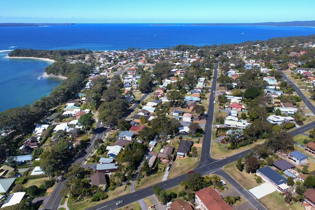 Orion Beach Cottage bottom right corner. This picture highlights the exceptional location the house has on offer. Hyams Beach to the right and Point Perpendicular to the left. Time to explore everything in between. Easy with the coastal walking / cycle path less the 5 mins walk.