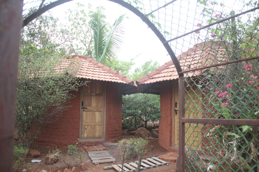 """The """"womb"""" huts are very cool inside and have attached bathroom with hot water. Each hut has been designed to sit in a secluded spot in the garden and has a fantastic view."""