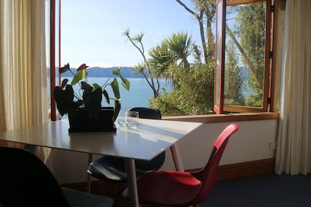 A toasty warm room with dramatic ocean views. - Lower Hutt