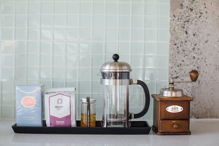 A small selection of tea and locally roasted coffee beans provided.