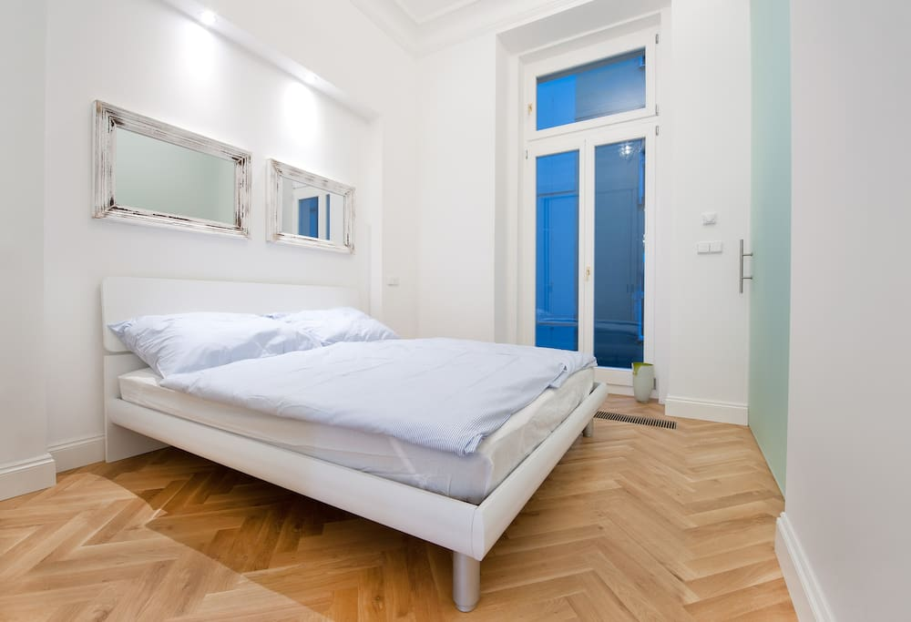 Comfortable double-bed with provided linens.
