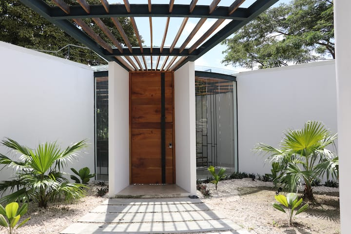 Contemporary architectural house in jungle canopy