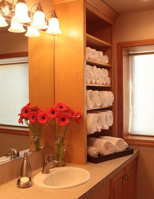 Bathroom with lots of fluffy white towels, two comfy robes and heated tile floor that your toes will love.